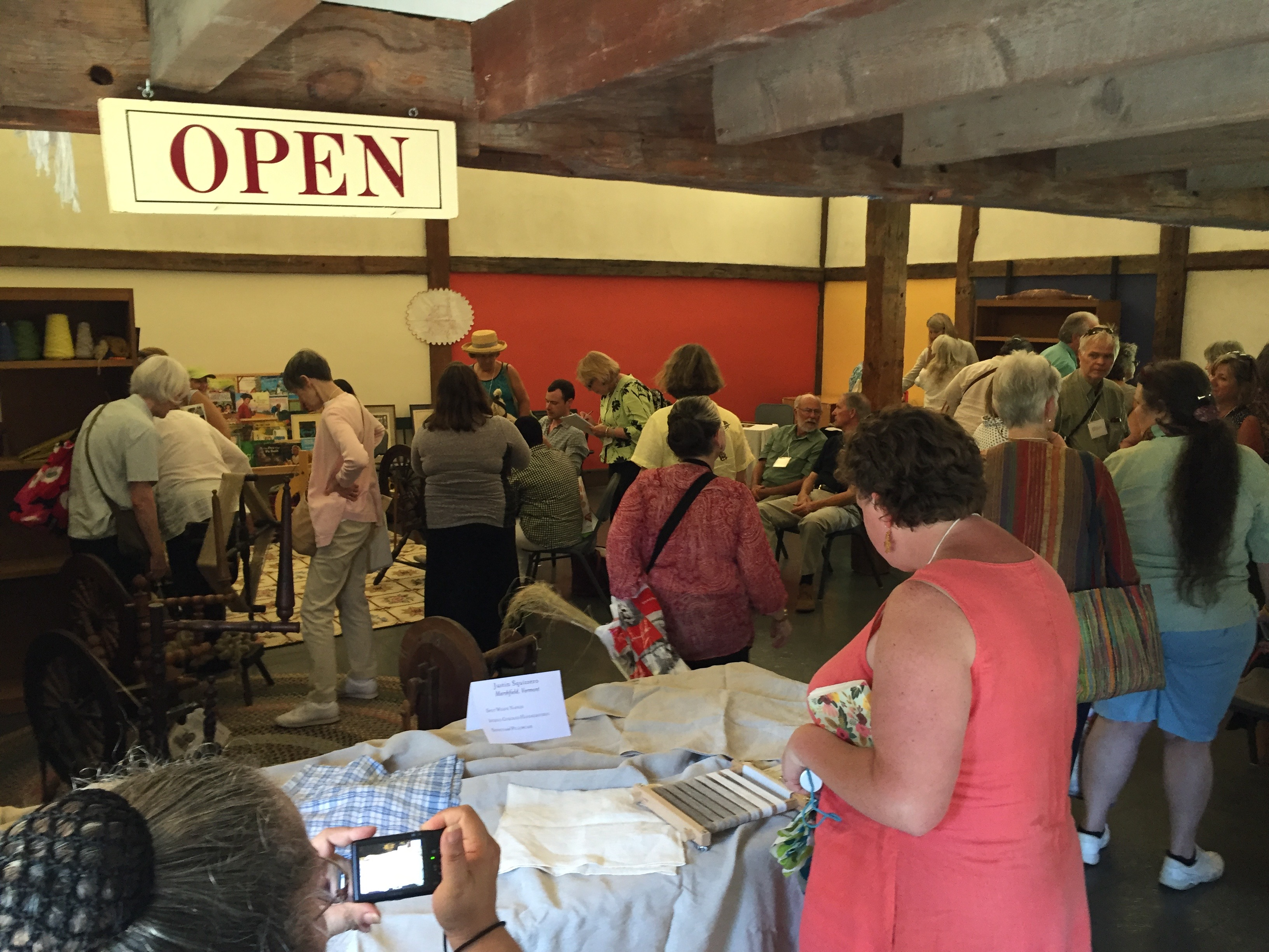 Photo of the spinning demonstration and antique linens room at the Flax & Linen Symposium 2016