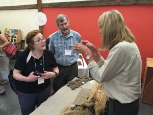 Photo of Cassie Dixon (right) at the Flax & Linen Symposium 2016